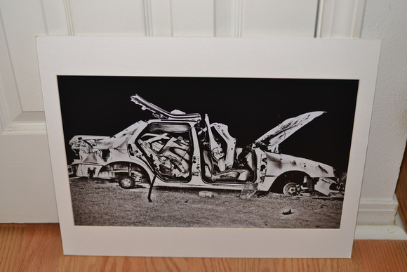 Matted photo of a car wreck for sale. $50.00+ S/H