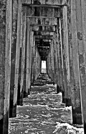 89 under the pensacola beach fishing pier in black and white black and white photography